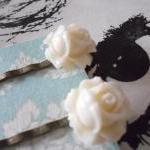 A Pair of Ivory White Vintage Roseb..